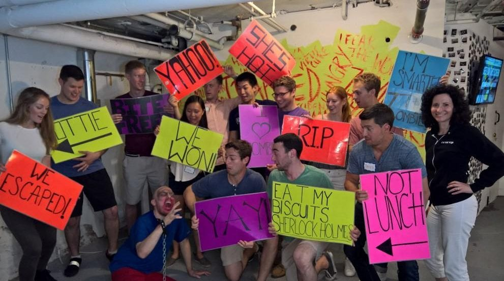 Image of students holding signs