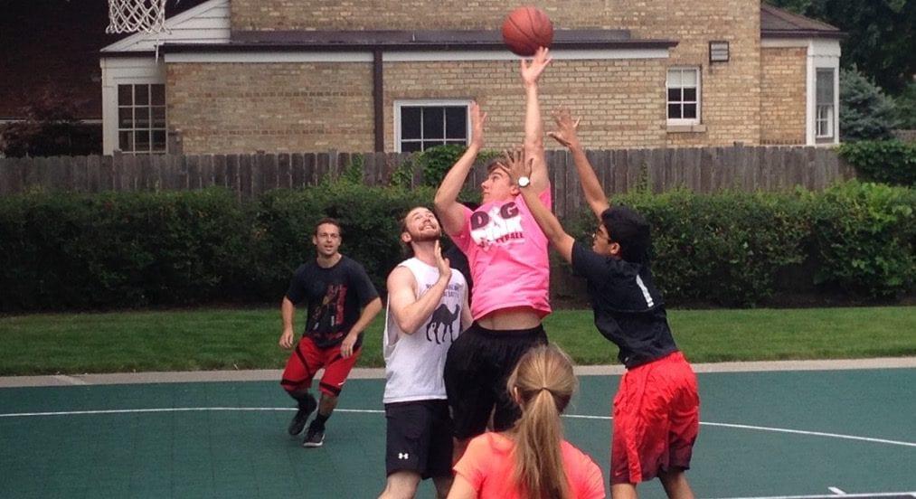 Image of students playing basketball