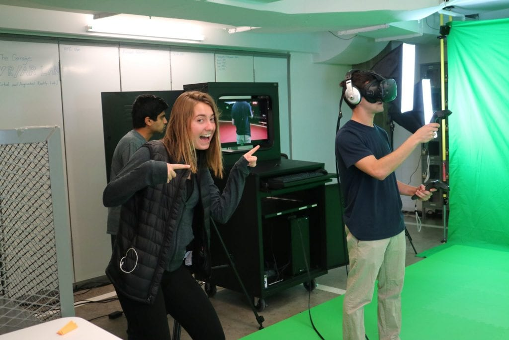Image of student using a virtual reality headset in the VR/AR lab
