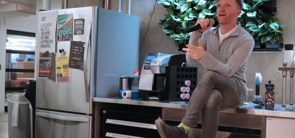 Image of Charles Adler speaking to students at Family Dinner