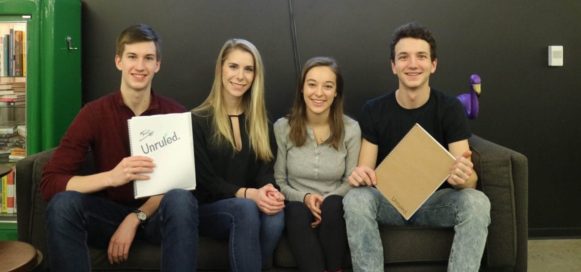 Image of Unruled team members sitting on a couch at The Garage