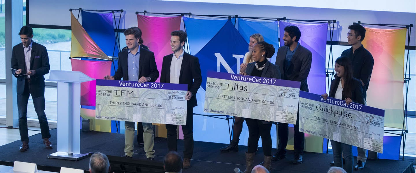 Image of VentureCat winners on stage