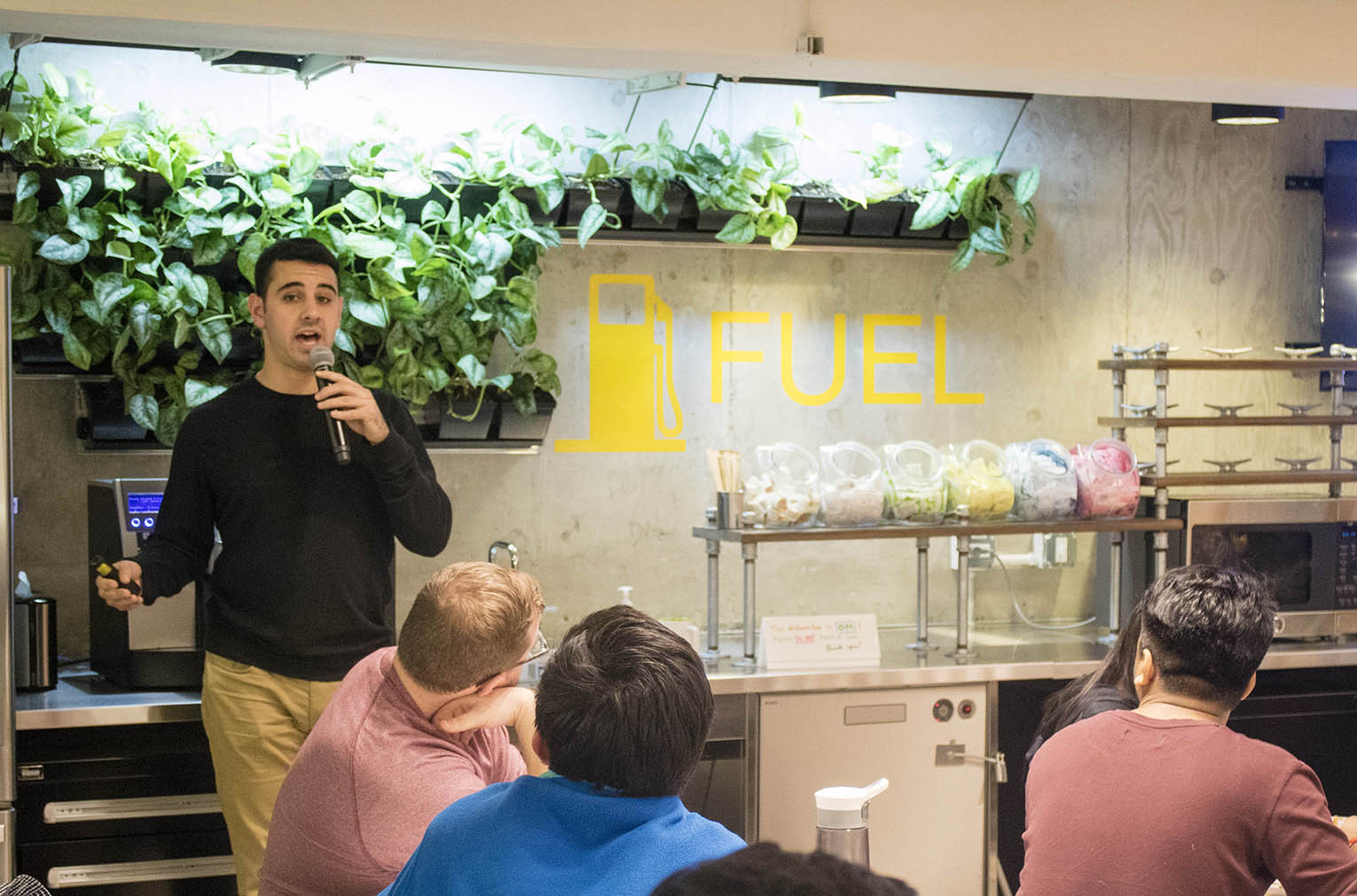 Image of zcruit Ben Weiss speaking to students during Family Dinner